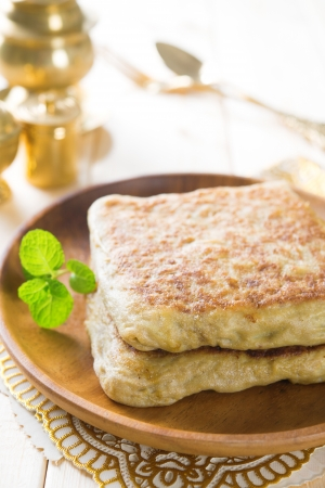 india food: Martabak or murtabak, also mutabbaq, is a stuffed pancake or pan-fried bread which is commonly found in Saudi Arabia, Yemen, India, Indonesia, Malaysia, Thailand, Singapore, and Brunei. Stock Photo