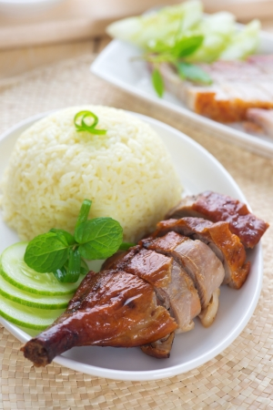 Roasted duck and roasted pork crispy siu yuk, Chinese style, served with steamed rice on dining table. Singapore cuisine. Stock Photo - 21373980