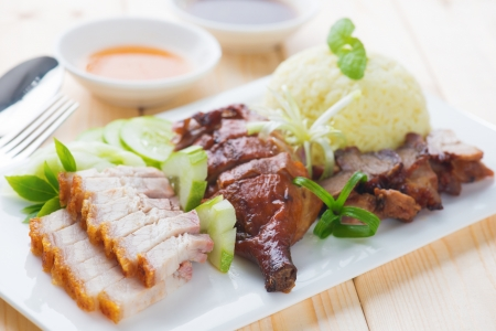 peking: Roasted duck, roasted pork crispy siu yuk and Charsiu Chinese style, served with steamed rice on dining table. Malaysia cuisine.