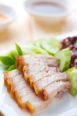 Siu Yuk or crispy roasted belly pork Chinese style and roast duck, served with steamed rice. Malaysia Chinese cuisines.