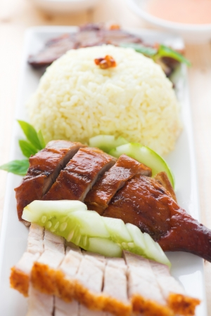 malaysia culture: Roasted duck and roasted pork crispy siu yuk, Chinese style, served with steamed rice on dining table. Malaysia cuisine.