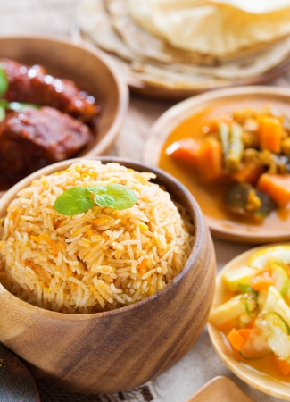 india food: Indian meal biryani rice, chicken curry, acar vegetable, roti chapatti and papadom.