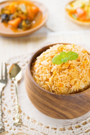 vegs: Indian vegetarian food. Biryani rice and curry dhal on dining table.