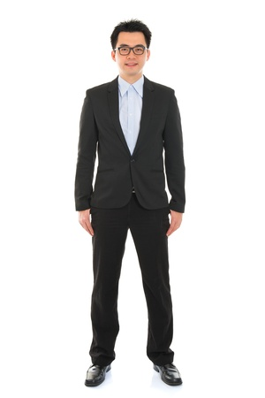 Confident full body Asian business man in formal full suit standing isolated on white background photo
