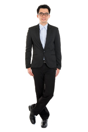 the whole body: Handsome full body Asian business man in formal full suit standing isolated on white background