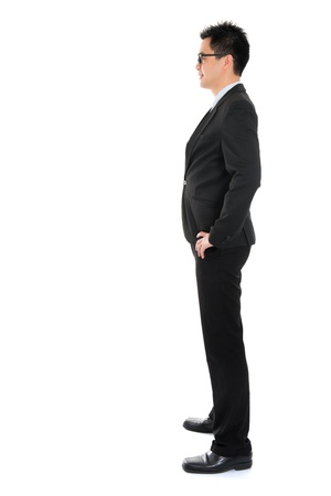 full suit: Side view full body Asian business man in formal suit standing isolated on white background Stock Photo