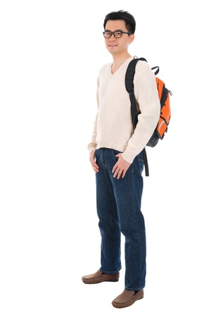 Full body Asian adult student in casual wear with school bag standing isolated on white background. Asian male model.