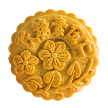 Traditional mooncake isolated on white background. Chinese mid autumn festival foods. The Chinese words on the mooncake means assorted fruits nuts, not a logo or trademark. photo