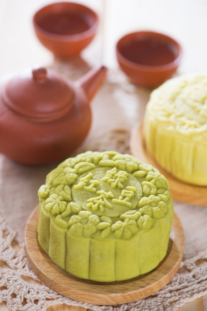 moon cake festival: Snowy skin mooncakes.  Traditional Chinese mid autumn festival food and tea set.