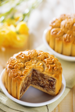 mid autumn: Sweet traditional mooncakes on table setting.  Chinese mid autumn festival foods.  Stock Photo