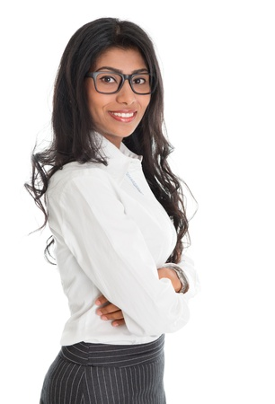Portrait of beautiful African American business woman smiling, standing isolated over white background. Mixed race Asian Indian and African American model. photo