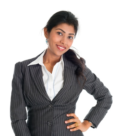 Portrait of attractive African American businesswoman in business suit, isolated over white background. Mixed race Asian Indian and African American model. photo