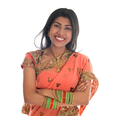 mid adults: Portrait of beautiful traditional Indian woman in sari dress smiling, isolated over white background.  Stock Photo