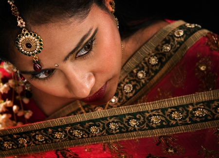 asian bride: Close up face of attractive young Indian woman in traditional sari dress Stock Photo