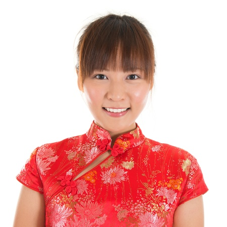 qipao: Asian woman with Chinese traditional dress cheongsam or qipao, close up face shot. Chinese new year concept, female model isolated on white background.