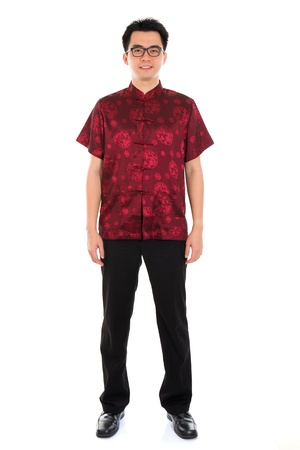 tang: Full body portrait Asian man with Chinese traditional cheongsam or tang suit. Chinese New Year concept. Male model isolated on white background. Stock Photo