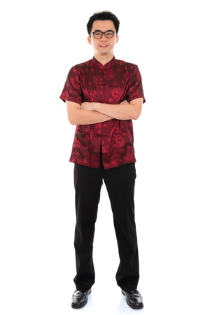 tang: Full body portrait Asian male with Chinese traditional cheongsam or tang suit. Chinese New Year concept. Male model isolated on white background. Stock Photo