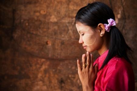 blessing: Beautiful traditional Myanmar girl in a praying pose.