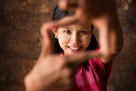 Beautiful young traditional Myanmar girl playing fun. photo