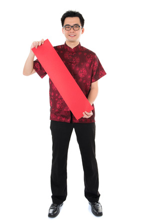 Full length Asian man with Chinese traditional cheongsam or tang suit holding couplet. Male model isolated on white background. photo