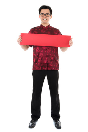 Full length Asian male with Chinese traditional cheongsam or tang suit holding couplet. Male model isolated on white background. photo