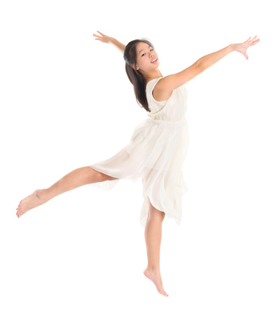 Modern Asian contemporary dancer poses in front of the studio background, full length isolated white. photo