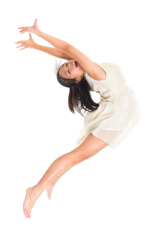 Modern young Asian teen contemporary dancer poses in front of the studio background, full length isolated white. photo