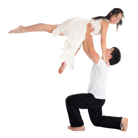 Modern young Asian teens couple contemporary dancers dancing in front of the studio background, full length isolated white. photo