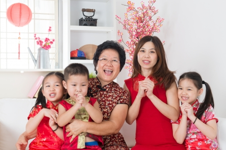 new generation: Happy chinese new year. Happy Asian family reunion at home.