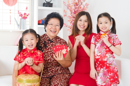 chinese family: Multi generations Asian family celebrate Chinese new year at home.
