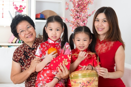 Beautiful multi generations Asian family celebrate Chinese new year at home. photo