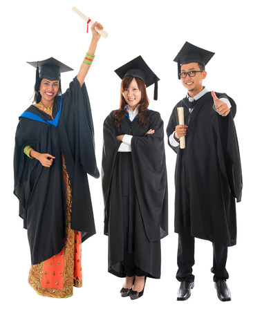 Full body group of multi races university student in graduation gown standing isolated on white background 스톡 콘텐츠