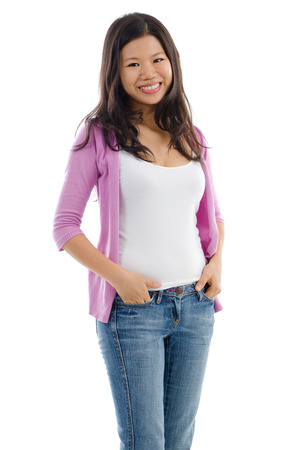Portrait of Asian female smiling and standing isolated over white background. photo