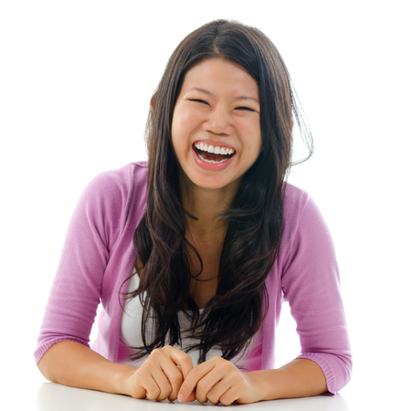 mouth opened: Candid portrait Asian woman laughing with mouth opened big. Sitting isolated on white background.