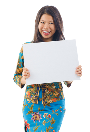 Asian woman in Kebaya holding a white blank card, kebaya usually worn by women in Indonesia, Malaysia, Brunei, Burma, Singapore, southern Thailand. photo