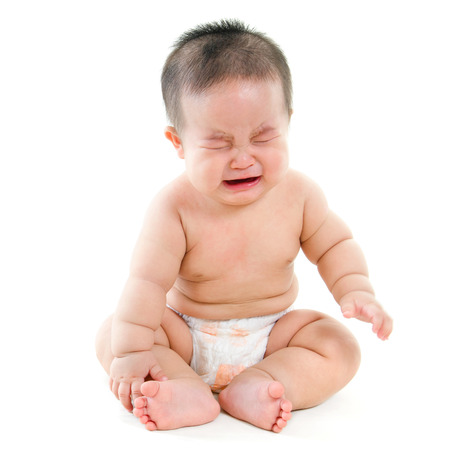 Full body hungry Asian baby boy crying, sitting isolated on white background Stock Photo