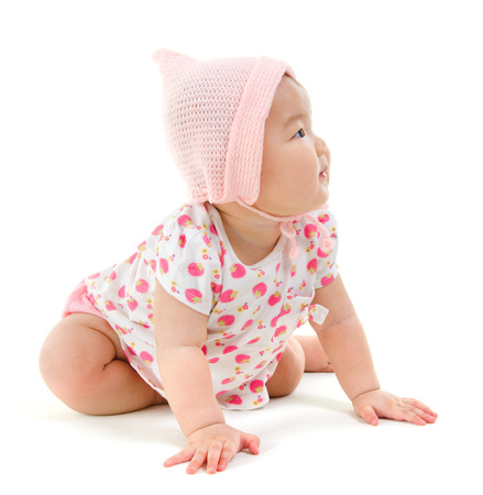 asian baby girl: Full body Six months old East Asian baby girl crawling on white background Stock Photo