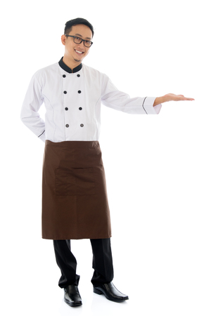 asian chef: Full body Asian male chef hand showing blank space, standing isolated white background.