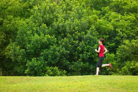 Asian girl jogging at outdoor park photo
