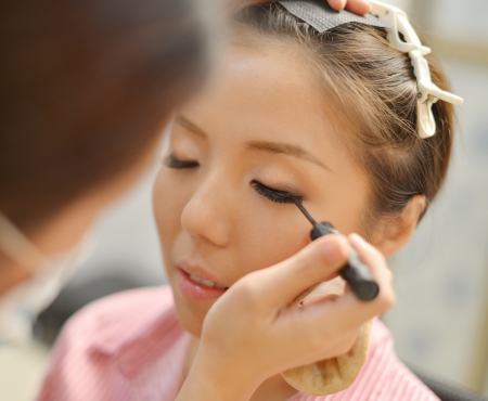 Asian Chinese bridal make up candid shoot. Wedding makeover preparation. photo