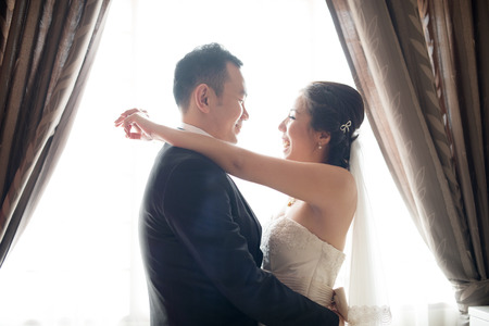 asian bride: Romantic Asian Chinese wedding couple. Bride and groom dancing on wedding day. Stock Photo