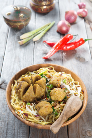 Mee bakso. Bakso or baso is Indonesian meatball  made from beef surimi. Popular local food in Indonesia.  Fresh hot with steam smoke.