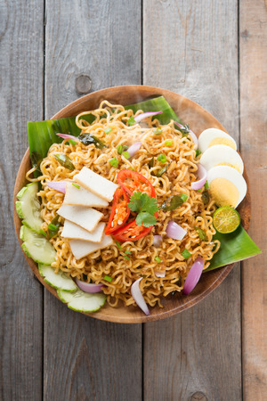 Malaysian style maggi goreng mamak or spicy dried curry instant noodles photo
