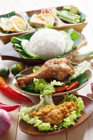 Famous traditional Malay food. Delicious nasi ayam penyet with sambal belacan photo