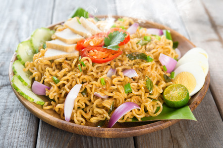 Malaysian style maggi goreng mamak or spicy fried curry instant noodles photo