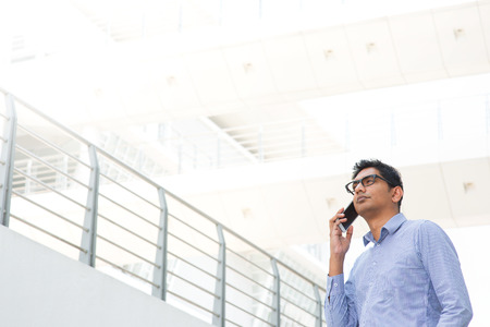 Young Asian Indian businessman on the phone photo