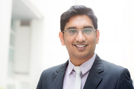 indian professional: Portrait of confident Asian Indian businessman smiling