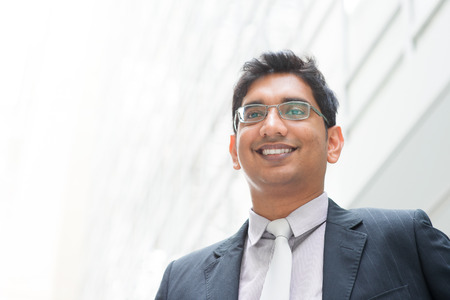 Portrait of happy Asian Indian businessman smiling Stock Photo