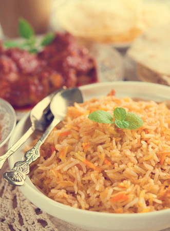 biryani: Indian cuisine biryani rice and chicken curry with retro effect.