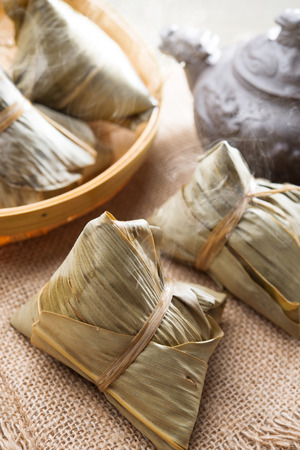 Asian Chinese tradition food - steamed rice dumpling with tea. photo
